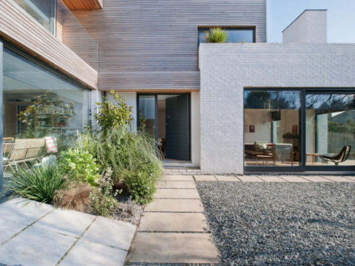 White Stone House Natural Wood Cladding